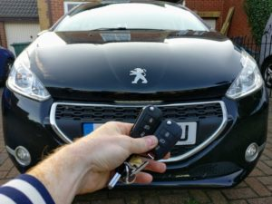 Peugeot 208 new 3 button key cut and programmed